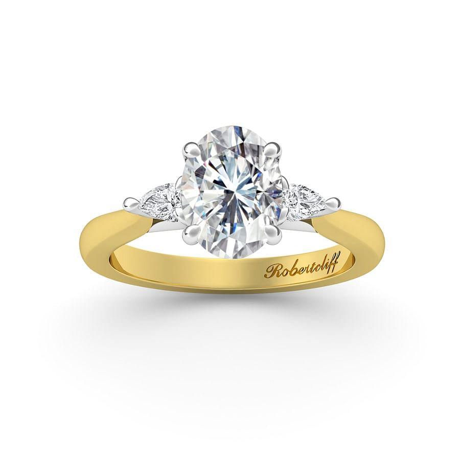 Trilogy engagement ring.